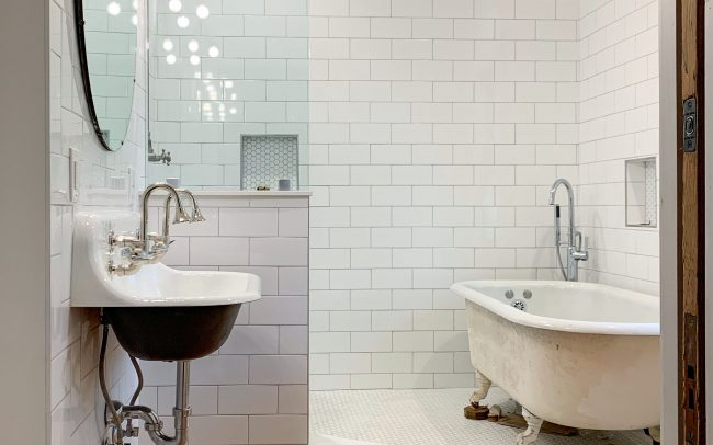 tiled vintage bathroom remodel with rainfall shower and clawfoot tub